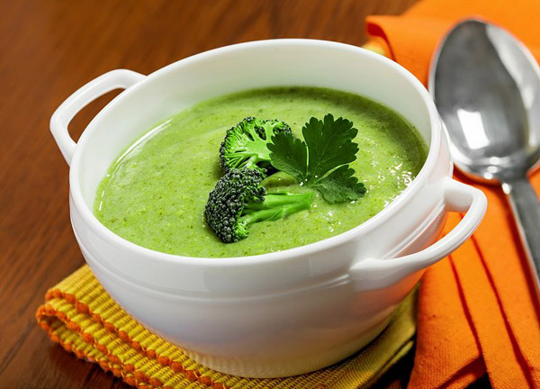 Broccoli cream soup on a tablecloth